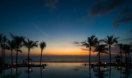 legian-bali-overview-pool-sunset-dark
